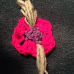 Crochet flower with yarn leaves